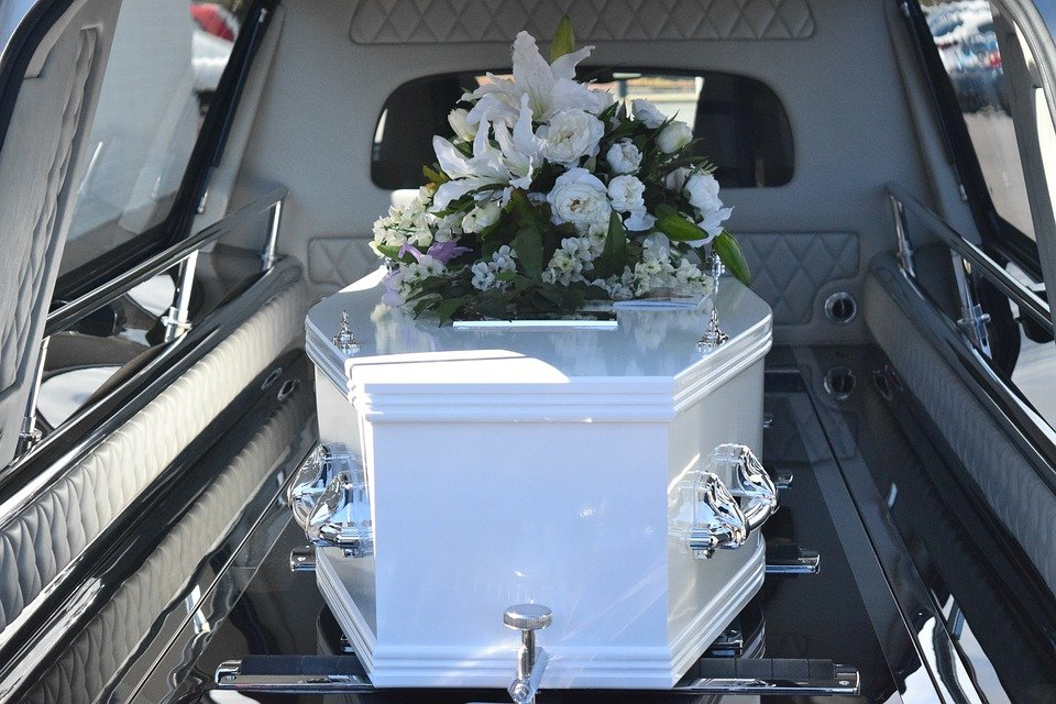 Planning a funeral - coffin in hearse